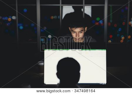 Asian Businessman Working Hard Late With Her Technology Laptop In Office, Customer Service And Call
