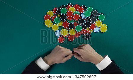 Winner Grabbing Pile Of Chips After Poker Game, Greedy Man Taking All Money