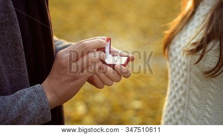 Man Proposing To Beloved Girlfriend In Autumn Forest, Romantic Atmosphere