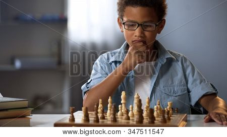 Little Boy Thinking On Chess Move, Intelligent Hobby, Logic Development, Leisure