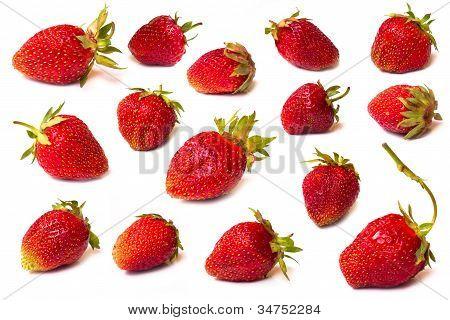 The fresh cut strawberries set on a white