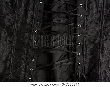 Fragment Of A Black Satin Corset With Lacing, Back View, Clothing Item