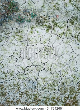 Surface Of A Grungy Dry Cracking Parched Earth For Textural Background.