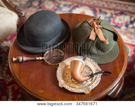 London, United Kingdom- June 2019: Sherlock Holmes Typical Objects On A Little Wooden Table: Deersta