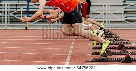 Start Race Male Athletes Runners Running In Starting Blocks