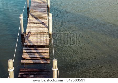 Wooden Platforms, Docks, Or Docks Along The River Hung With A Rope