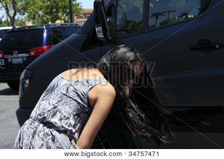 CALABASAS  - MAY 27: Selena Gomez, Justin Bieber at the Commons shopping center shortly after Justin Bieber had a run in with a photographer on May 27, 2012 in Calabasas, California