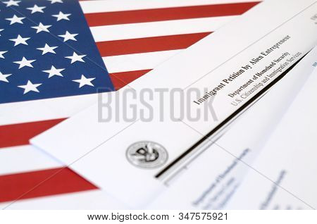 I-526 Immigrant Petition By Alien Entrepreneur Blank Form Lies On United States Flag With Envelope F