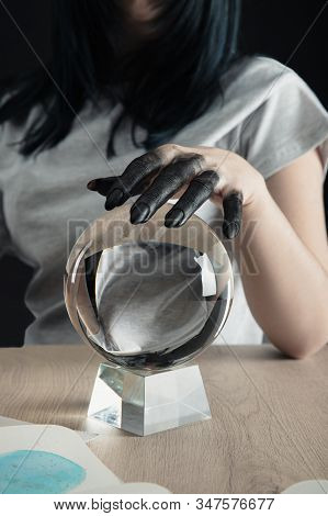 Cropped View Of Fortuneteller With Black Paint On Hand Holding Crystal Ball By Watercolor Painting O