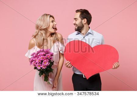 Laughing Young Couple Two Guy Girl In Party Outfit Celebrating Posing Isolated On Pink Background. V