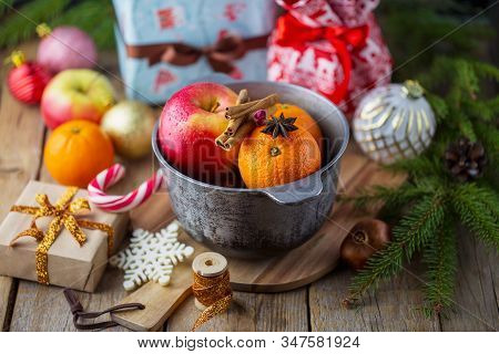 Christmas Red Wine Mulled Wine With Spices And Fruits On A Wooden Table. Winter Concept. Traditional