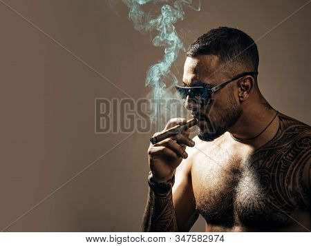 Expensive Tobacco. Tattooed Man With Cigar. Cigar Smoking Enjoy Life Moment. Bearded Muscular Macho