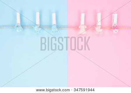 Gender Reveal Party Invitation Concept. Background Photography Of Small Pegs With Carriage Toys Isol