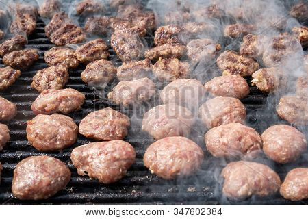 Grilled Hot Meatballs At Picnic In Rotisserie