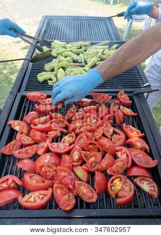 Grilled Tomatoes And Papers At Picnic In Rotisserie