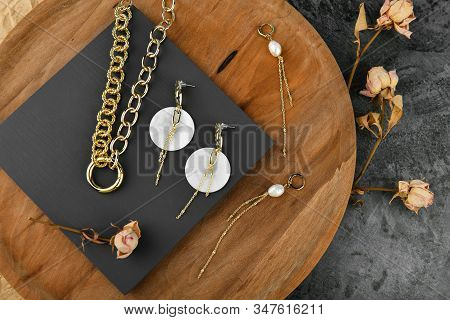 Handmade Gold Jewelry For Women. Jewelry For All Lovers. Chains On A Wooden Background. View From Ab