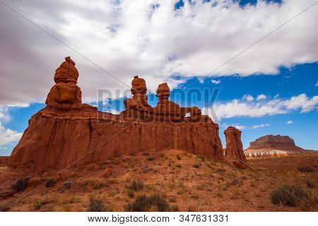 Original red brown sandstone formations resulting from erosion. USA. Scenic Utah state park Goblin Valley. Hoodoo - geological formations. The concept of active, ecological
