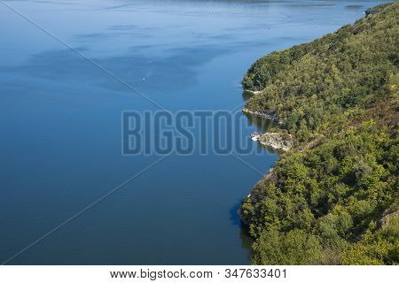 Top View Aerial Landscape Sea Side Forest Edge Waterfront Coast Line Blue Water Surface And Green Fo