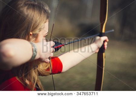 Girls Dressed As A Medieval Teaching Archery At The Field