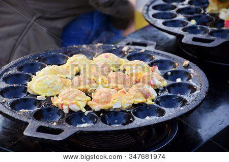 Pan Fried Egg With White Pork Sausage Toppings Or Takoyaki Thai Style For Breakfast