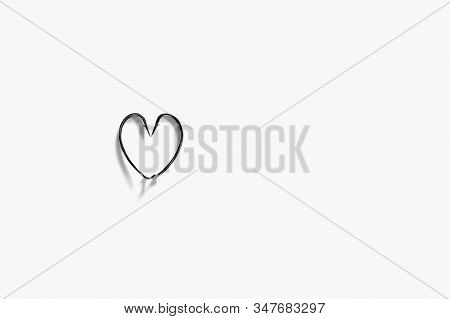The Metal Hooks Placed Heart Symbols Isolated On A White Background. Fishing Hook Close Up. Fishing