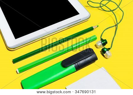 Set Of Business Or Education Accessories Close Up. Green Pencils, Headphones, Paper Stickers, Marker