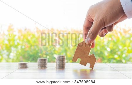 Money Saving Coins Stack With Growing Interest In The Public Park On Wood Table Concept For Wooden H