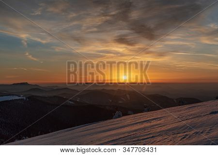 Sunset From Veterne Hill On Martinske Hole In Mala Fatra Mountains In Slovakia During Winter With Co