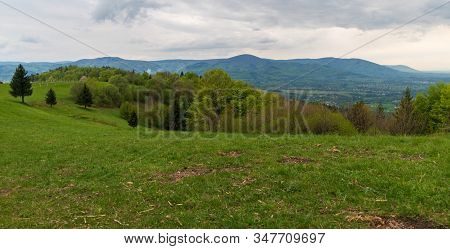 Springtime Slezske And Moravskoslezske Beskydy Mountains Scenery With Meadows, Trees And Hills From