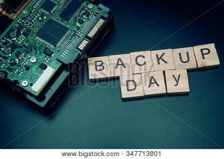 Words In English Backup Day. Copy Space For Text. Hdd Hard Drive. Hard Disk On Black Dark Background