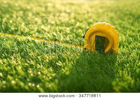 Artificial Turf Background With Measuring Tape, Sunny Weather