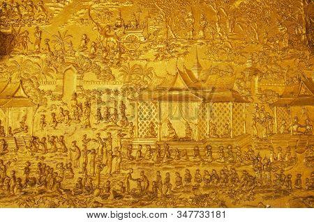 Luang Prabang, Laos - April 16, 2012: Golden Exterior Wall Decoration Of The Wat Xieng Thong Buddhis