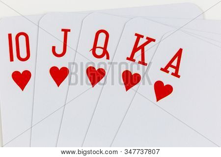 Playing cards, straight on white background macro photo