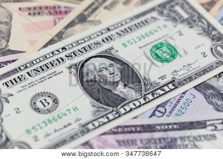 Business background, one dollar bill on american banknotes close up in studio