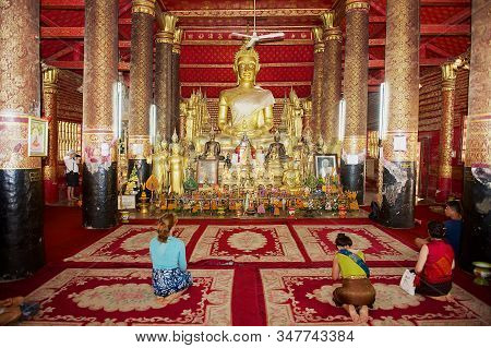 Luang Prabang, Laos - April 16, 2012: People Pray In Wat Mai Suwannaphumaham Buddhist Temple In Luan