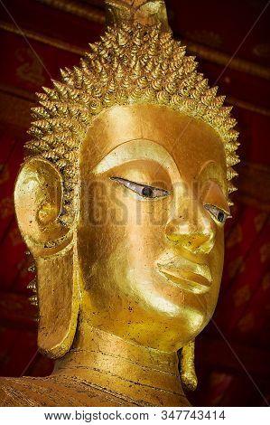 Luang Prabang, Laos - April 16, 2012: Buddha Statue Head In Wat Mai Suwannaphumaham Buddhist Temple
