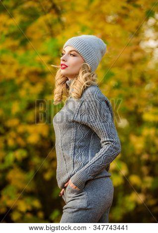 Woman Enjoy Autumn Season In Park. Warm Knitwear. Feel Practicality And Comfort. Model Knitwear Clot