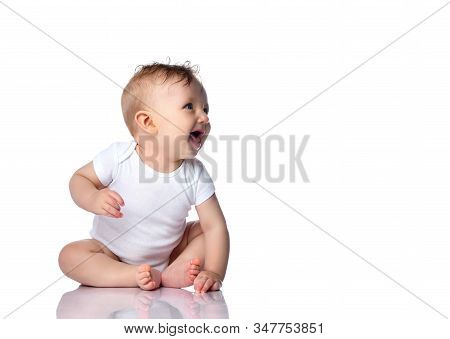 Happy Laughing Barefooted Infant Child Baby Boy Toddler In White Bodysuit With Copyspace Blank Is Si