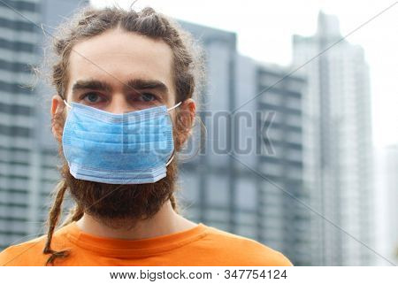 Male in mask for protection against bacteria, virus 2019-nCoV