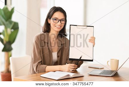 Questionnaire For Students. Young Beautiful Woman Holding Clipboard With Copyspace In A University C
