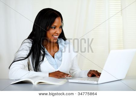 American Young Black Woman Working On Laptop