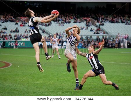 MELBOURNE - JUNE 30 : Alan Tookey rushes in to take a mark during Collingwood's win over Fremantle on June 30, 2012 in Melbourne, Australia.