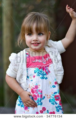 Outdoor location of cute toddler girl posing