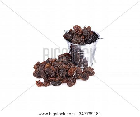 Dried Black Raisins In Zinc Bin And On White Background