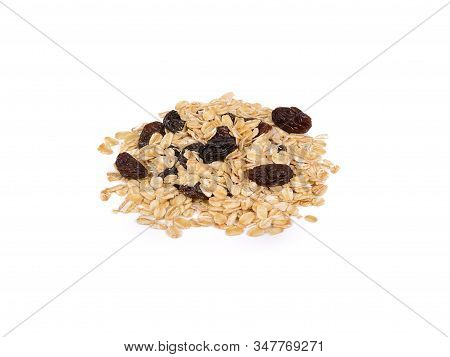 Pile Of Dried Black Raisins And Oatmeal On White Background