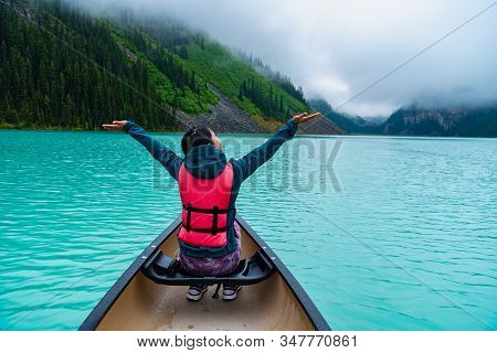 Woman Enjoying The Canoe And View Of Lake Louise Banff Canada