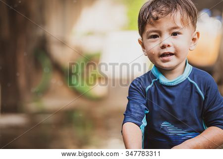 Cute Young Boy Playing Outside In Nature