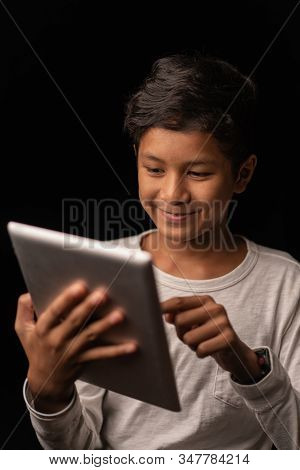Young Asia Boy Have A Good Time With His Tablet