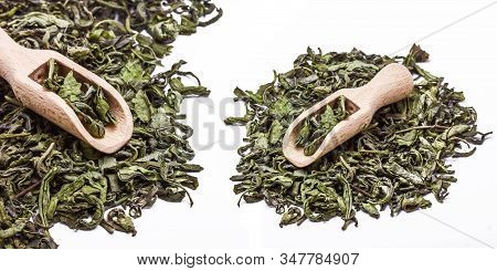 Green Tea Is Healthy Alternative For Coffee. Dry Leaves Pile Of Green Asian Plant. Small Wooden Scoo