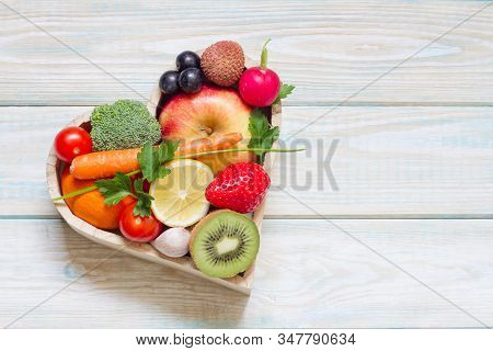 Healthy Food In Heart And Cholesterol Diet Concept On Blue Boards